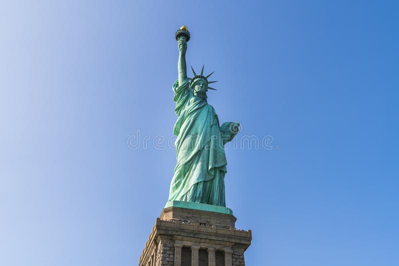 The statue of Liberty with blue sky background. stock image