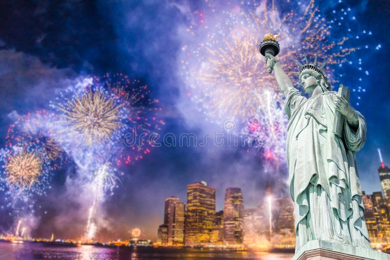 The Statue of Liberty with blurred background of cityscape with beautiful fireworks at night, Manhattan, New York City royalty free stock images