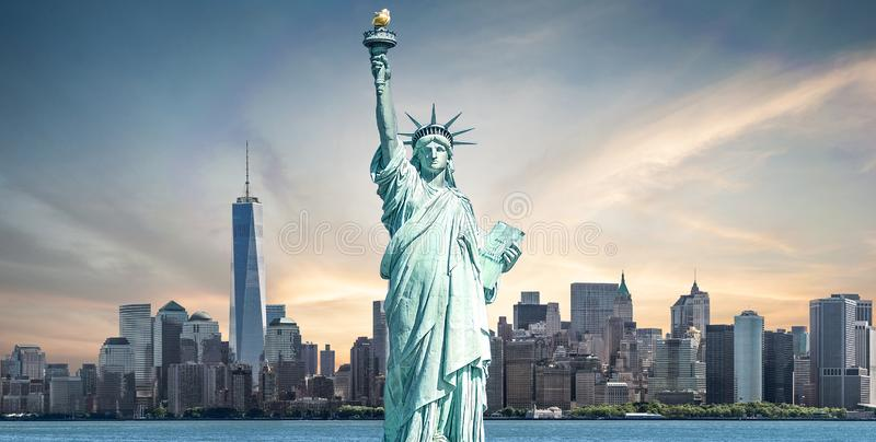 The Statue of Liberty with high-rise building in Lower Manhattan. Background, Landmarks of New York City, USA stock photography