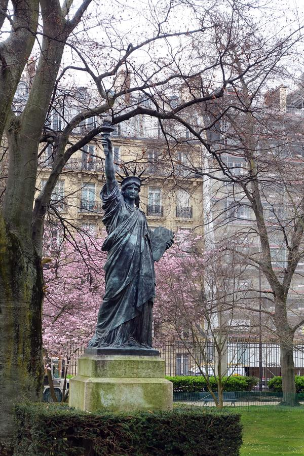 Statue of Liberty, Jardin du Luxembourg, Paris, France. American visitors are surprised to find a bronze replica of the American Statue of Liberty originally royalty free stock images