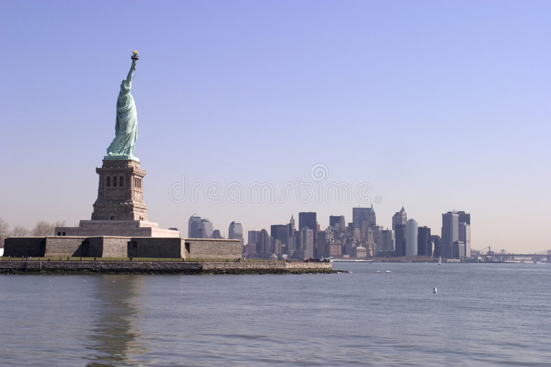 The Statue of Liberty and lower Manhattan skyline - New York stock images