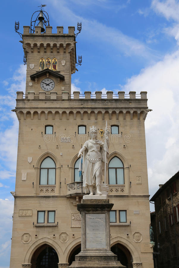 Statue of Liberty in the main square of microstate of San Marino. And the ancient palace called Palazzo Pubblico seat of Government stock photo