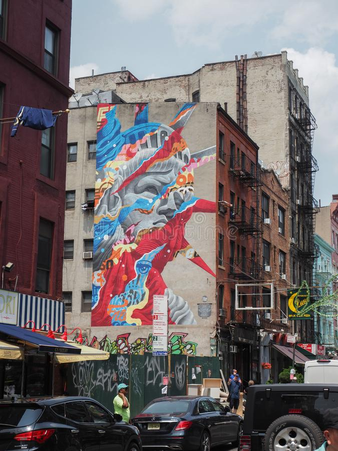 Statue of Liberty mural painting by Tristan Eaton. New York, USA - May 31, 2019: Statue of Liberty mural painting by Tristan Eaton. The artwork is visible from royalty free stock photos