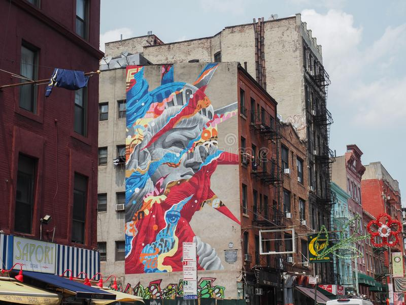 Statue of Liberty mural painting by Tristan Eaton. New York, USA - May 31, 2019: Statue of Liberty mural painting by Tristan Eaton. The artwork is visible from stock images