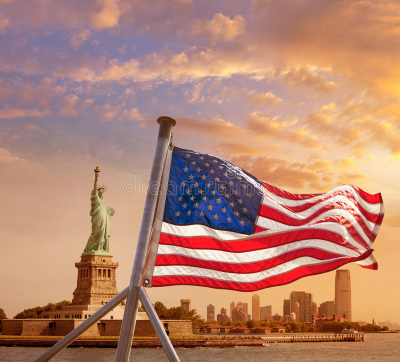 Statue of Liberty New York American flag royalty free stock image