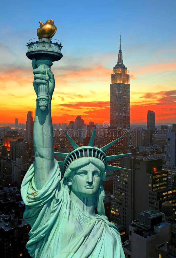 The Statue Of Liberty And New York City Skyline Stock
