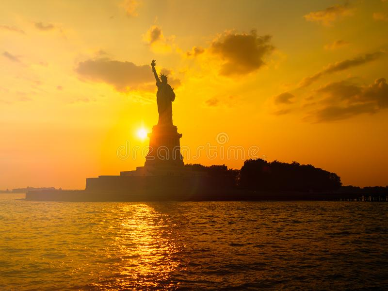 The Statue of Liberty in New York City at sunset royalty free stock image