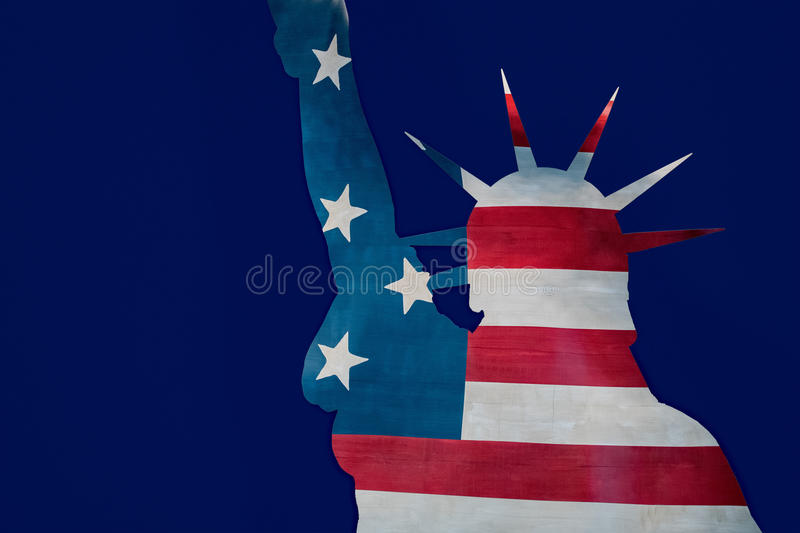 Statue of liberty in New York silhouette on usa star and stripes flag royalty free stock photos