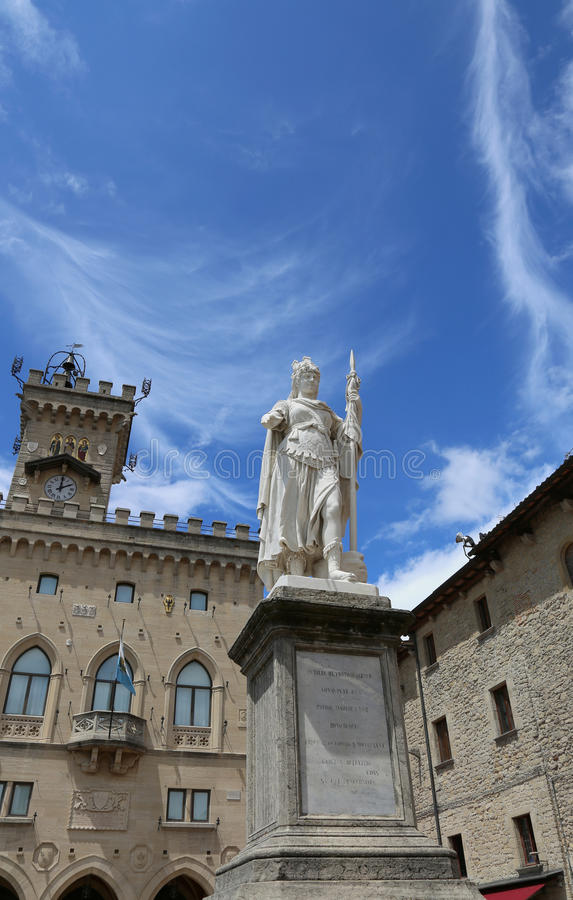 Statue of Liberty in San Marino Country and the seat of Governme. Statue of Liberty in the main square of microstate of San Marino and the ancient palace called stock image