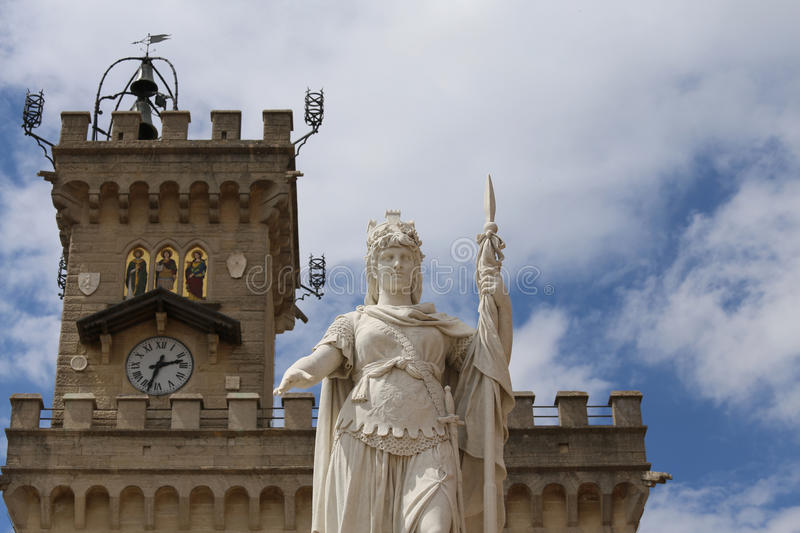 Statue of Liberty in San Marino Microstate. Marble Statue of Liberty in San Marino Microstate and the tower stock photo