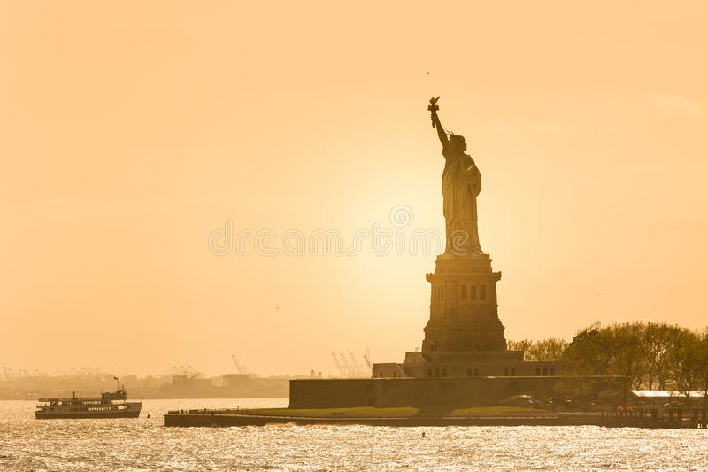 Statue of Liberty silhouette in sunset, New York City, USA.  royalty free stock photography