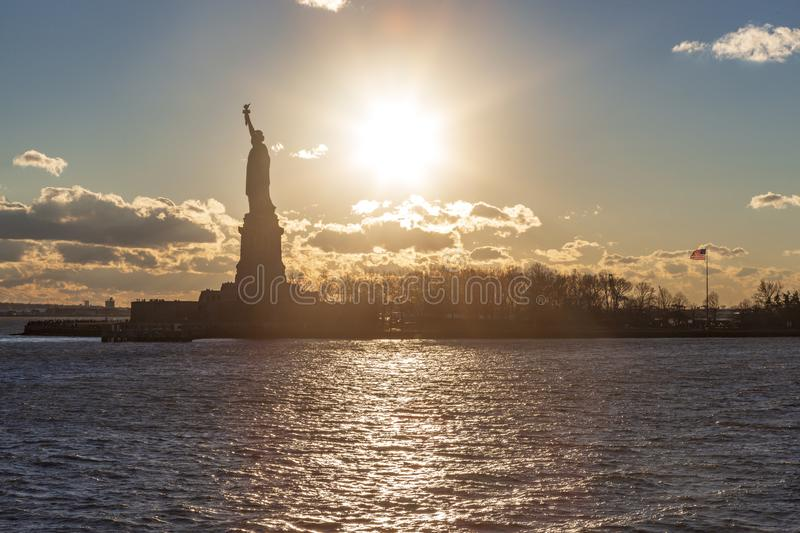 Statue of liberty silhouette during sunset in New York, NY. USA royalty free stock images