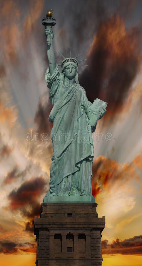 Statue of Liberty at sunset royalty free stock photos