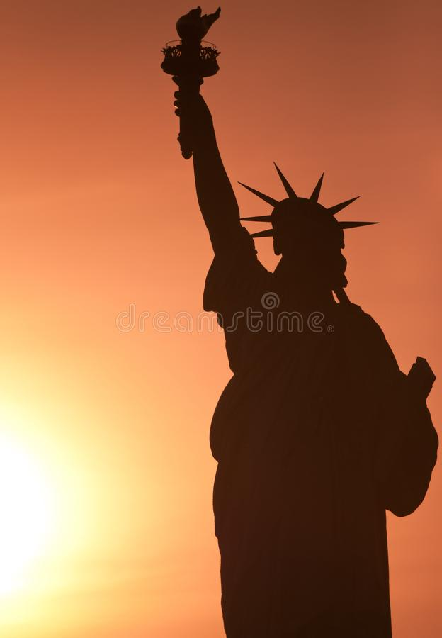 Statue of Liberty. At sunset with beautiful warm colors stock photography