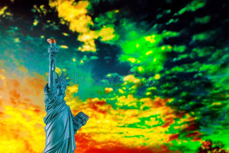 Statue of liberty at sunset with sun and orange sky Symbol US. Statue of liberty at sunset with sun and orange sky American Symbol US, freedom, nyc, independence royalty free stock photos