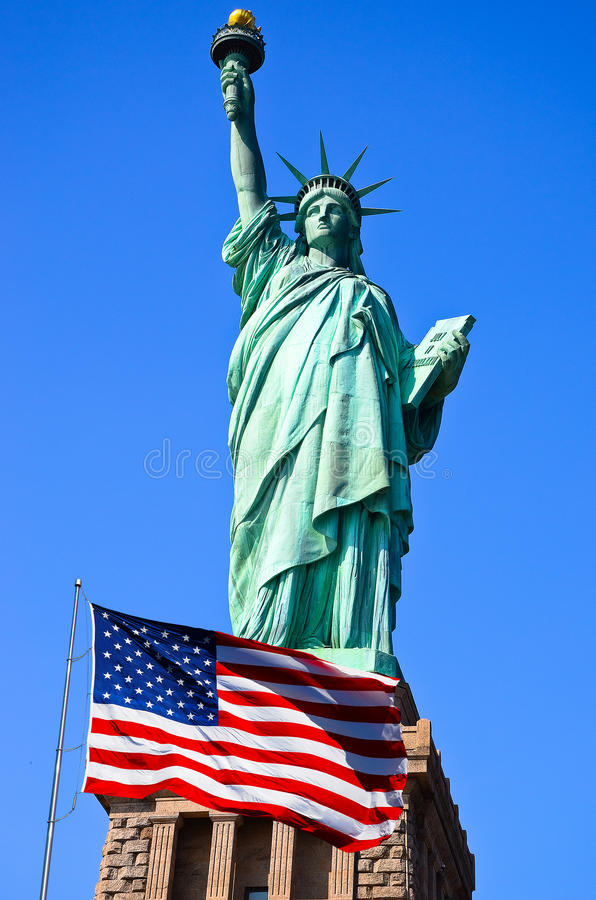 Statue of Liberty and United States flag in New York City. Statue of Liberty and United States flag in New York stock images