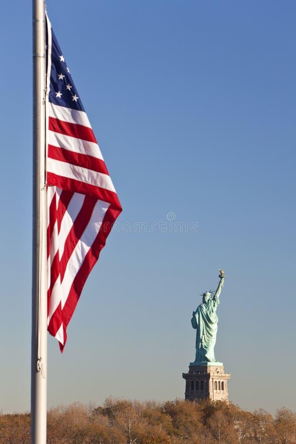Statue of Liberty, US Flag, New York City stock photos