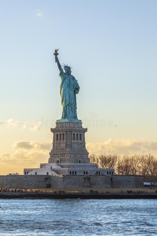 Statue of liberty vertical during sunset in New York City, NY, royalty free stock photos