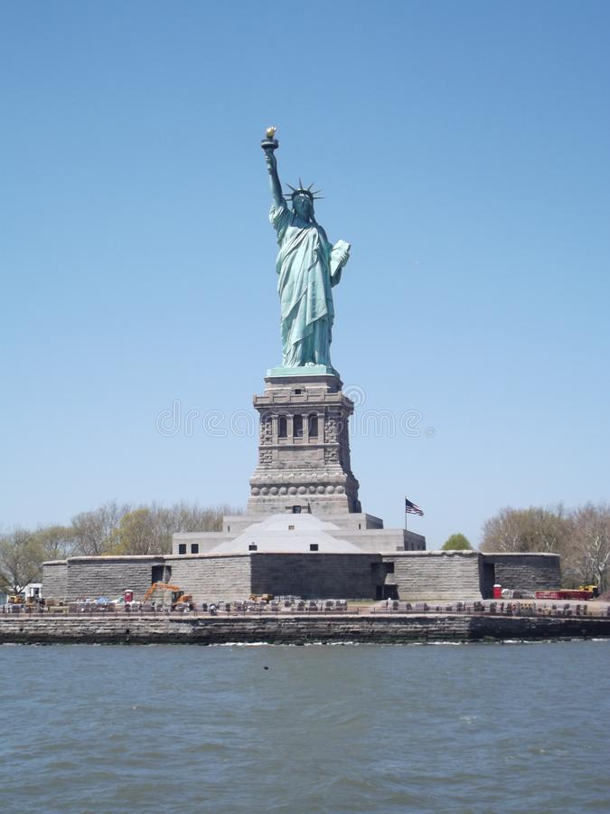 The Statue of Liberty via ferry stock photography