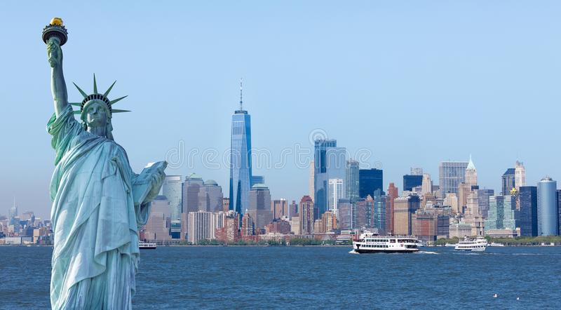 The statue of Liberty with World Trade Center background. Landmarks of New York City stock photography
