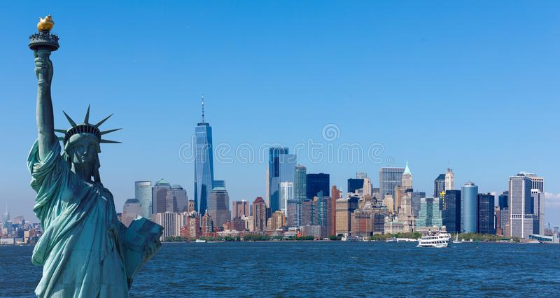 The statue of Liberty with World Trade Center background. Landmarks of New York City royalty free stock images