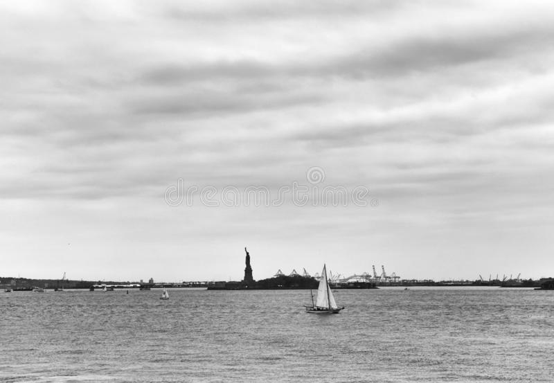 Statue of Liberty and yacht, New York City, NY, USA stock images