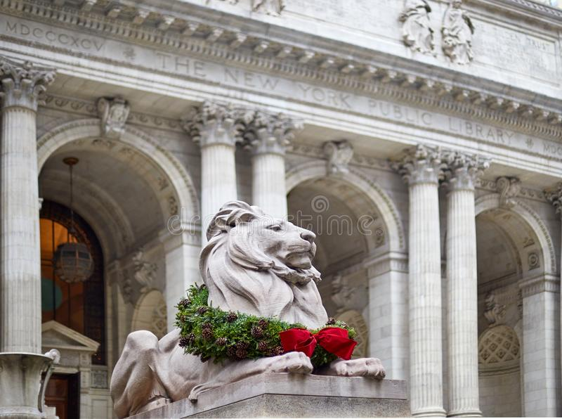 Statue of the lion in the new york library decorated for christmas. Close up of statue of the lion in the new york library decorated for christmas stock photography
