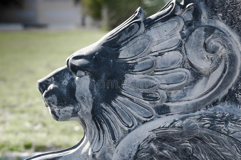 The regal lion cries. A statue of a Lion that seems to be crying while watching an event royalty free stock photography