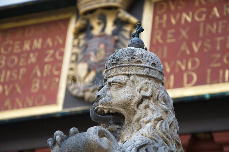 Statue of a lion with tongue and crown royalty free stock images