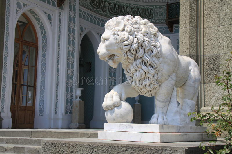 Statue of a Lion. Vorontsov Palace in Alupka, Crimea. It was built in 1828-1846 in an extravagant mixture of Scottish baronial and Neo-Moorish styles. Designed royalty free stock images