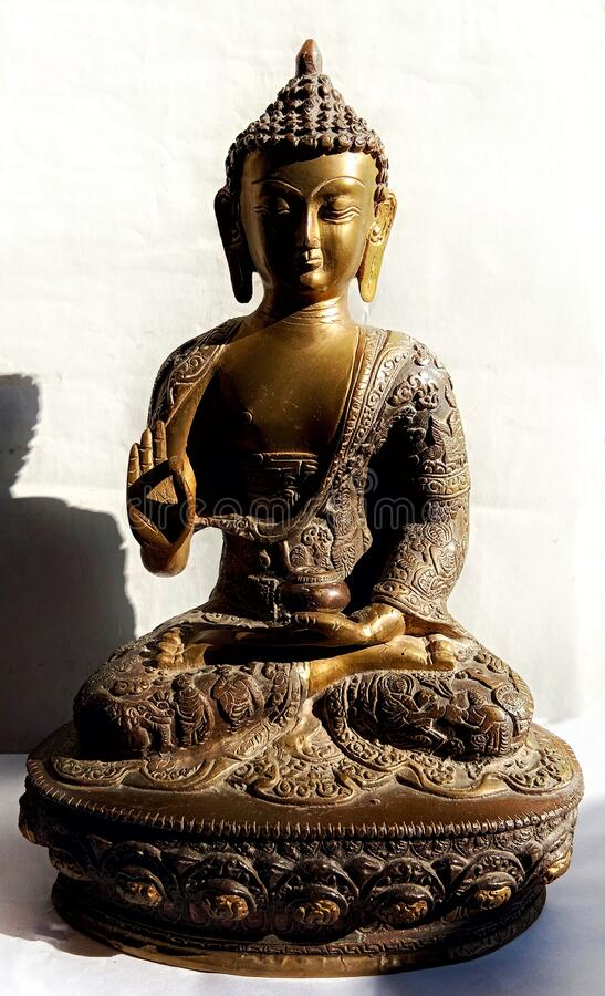 Statue of Lord Buddha - golden brown stock images
