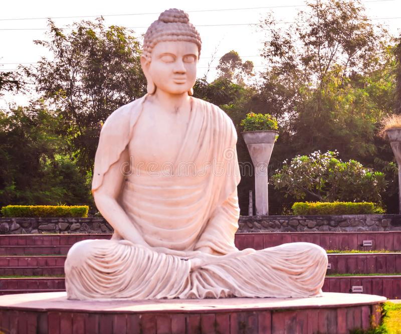 STATUE OF LORD BUDDHA I A PUBLIC PARK stock photography