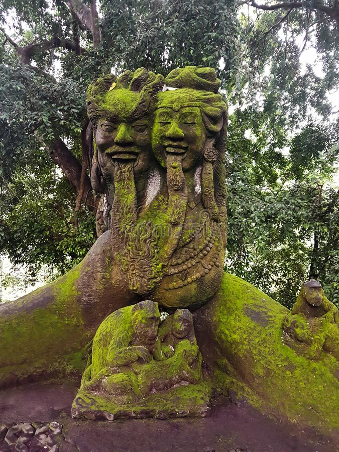 Statue of Lord Shiva influenced by Balinese mythology in Monkey Forest, Ubud, Bali, Indonesia royalty free stock photo