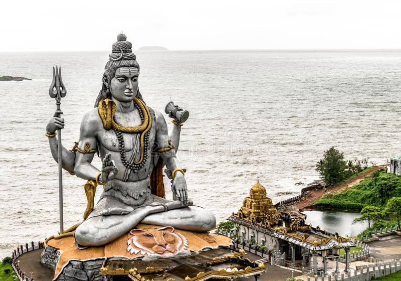 Statue of Lord Shiva in Murdeshwar, Karnataka. This 123 feet statue is at Arabian sea coast and is second tallest. Very Famous and Magnificent statue of Lord stock photography