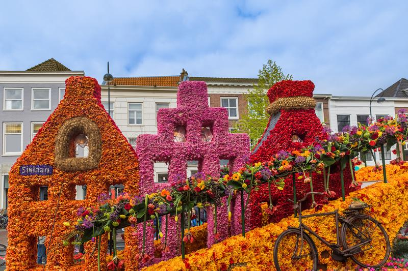 Statue made of tulips on flowers parade in Haarlem Netherlands. Holiday background royalty free stock images