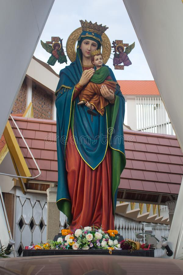 The statue of Madonna with the Child in front of the Church royalty free stock photography