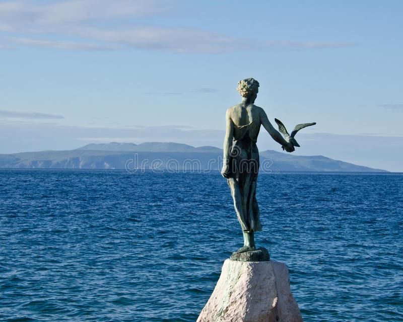 The statue of the Maiden with the Seagull located on the Adriatic Sea, Opatija, Croatia. stock images