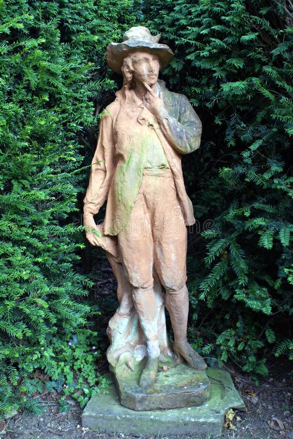 Statue of a man in a garden. For decoration stock photos