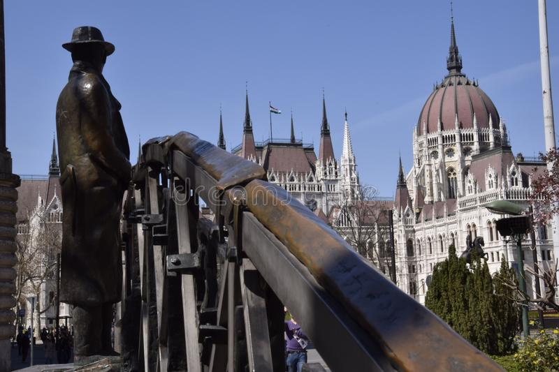A statue of a man with hat in Budapest royalty free stock images