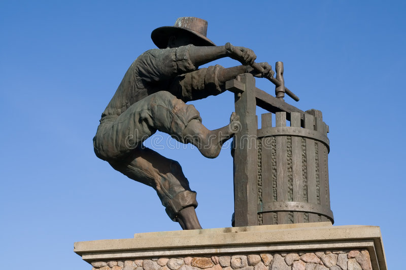 Statue of a man making wine royalty free stock images
