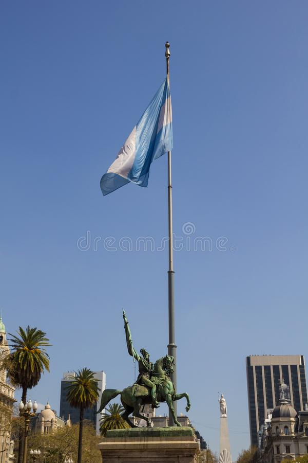 The Statue of Manuel Belgrano on the Plaza de Mayo in Buenos Air. Es, Argentina. Down, to the bottom on the right, the pyramid of May stock images