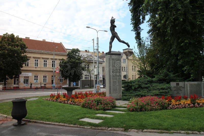 Statue of Marathon runner on square of Peace Marathon in Kosice stock image