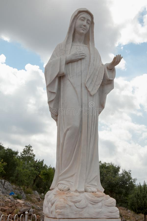 Statue of Mary on Apparition Hill in Medjugorje, Bosnia-Herzegovina. This is a picture of the statue of Mary on Apparition Hill in Medjugorje, Bosnia-Herzegovina stock images