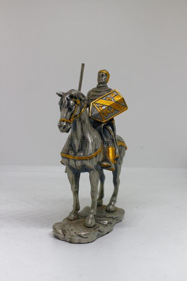 Statue of a medieval mounted knight in armour on White background. A knight is a man granted an honorary title of knighthood by a monarch, bishop or other stock photos