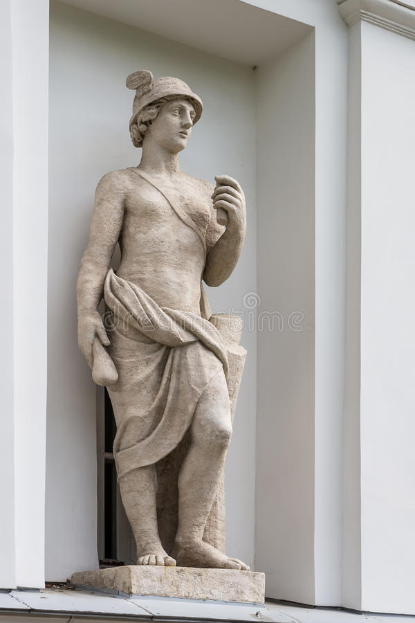 Statue of Mercury in the niche of the Kitchen Corps of the Elagin Island Palace and Park Complex in St. Petersburg. The God Mercury. Statue of Pudozh stone in stock photography