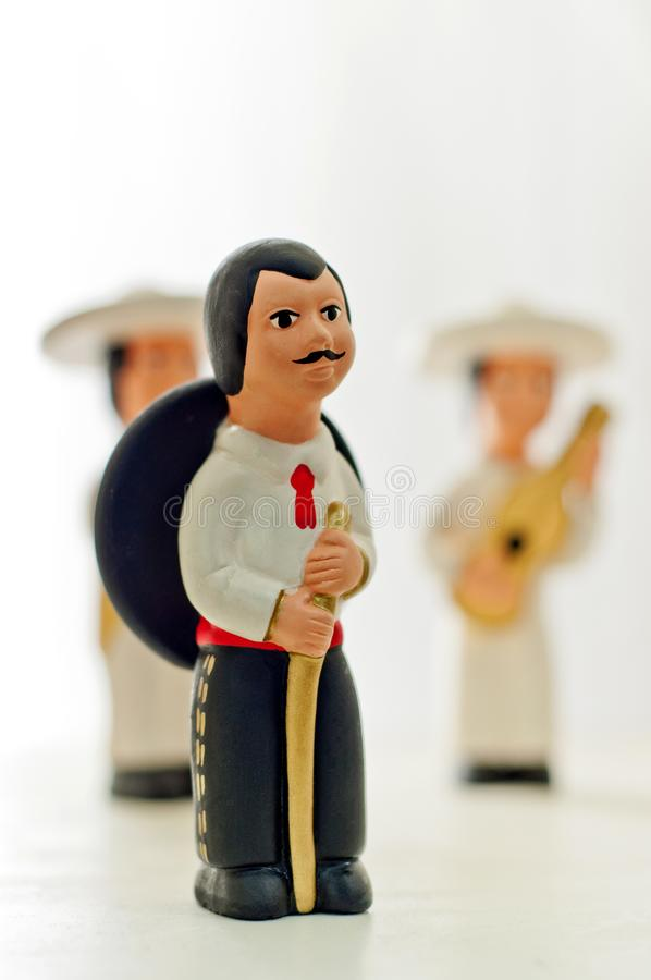 Statue of mexican man with sombrero on a white background royalty free stock image