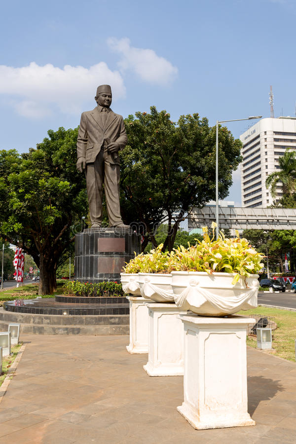 Statue of Mohammad Husni Thamrin in jakarta. JAKARTA - August 10: The Statue of Mohammad Husni Thamrin (or populary known as MH Thamrin), located on Medan royalty free stock photos