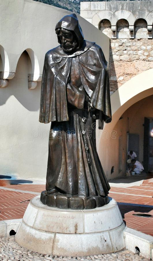 Statue of the monk in front of the Royal Palace in the State Monaco. The stone statue of the monk in front of the Royal Palace in the State Monaco royalty free stock photos