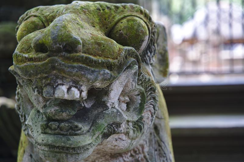 Statue in the monkey forest of Ubud stock photography