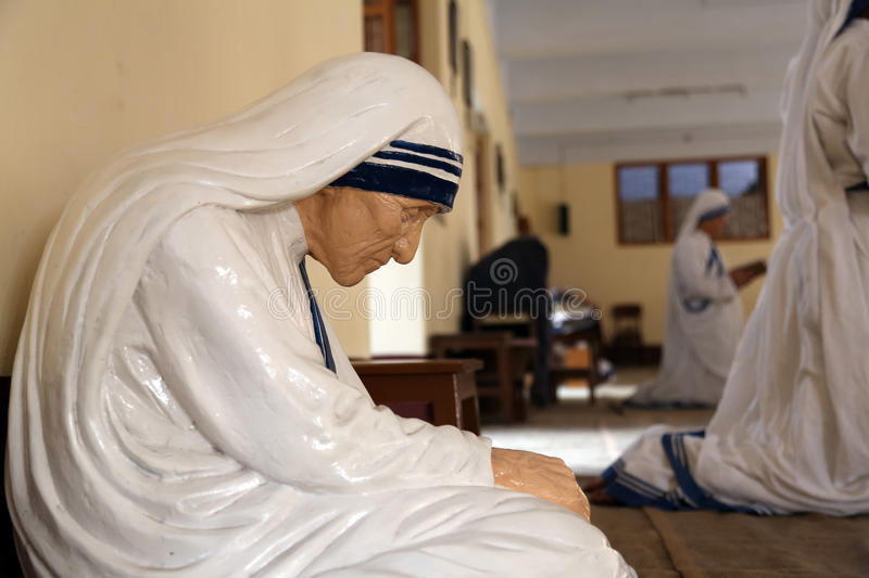 The statue of Mother Teresa in the chapel of the Mother House, Kolkata. India at 8 February 2014. The statue was made in the pose in which the Mother prayed royalty free stock image